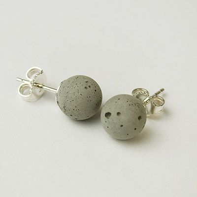 A clever, modern take on a classic jewelry style, these cement earrings are modeled on pearl studs. Each concrete sphere is cast by hand and set onto a .