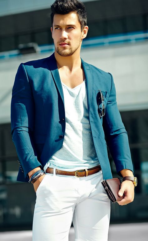 Business Casual. Men, check out this classic spring / summer business casual style featuring white chinos, a navy blazer, with brown accessories.