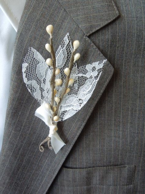A few twigs, faux #lace leaves, and a beautiful bow combine to create an unforgettably romantic #boutonniere. (Plus, we'll give your guy kudos for wearing lace!)