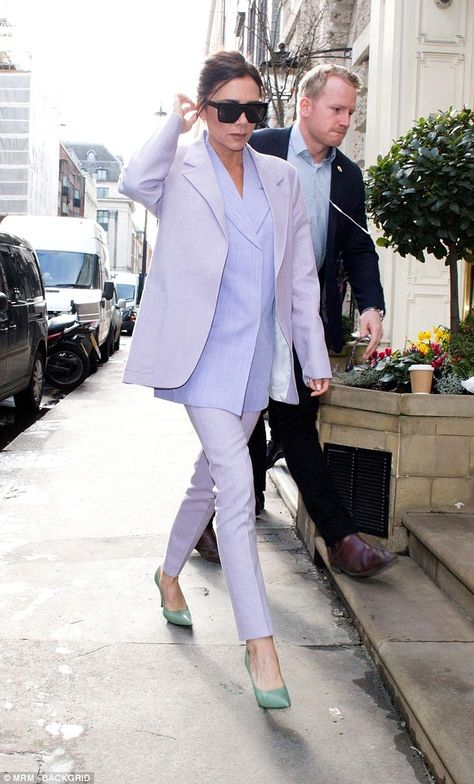 She wears the trousers! Victoria Beckham stood out in a lilac suit with contrasting mint heels as she headed to her Dover Street store in London to promote her line on Thursday