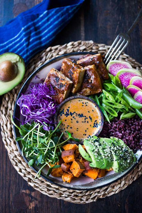Bali Bowl with Peanut Tofu, black rice, roasted sweet potatoes, shredded cabbage, radish and snow peas. #peanutsauce #peanuttofu #healthybowl #veganbowls #buddhabowls #vegan #plantbased #cleaneating #eatclean #detoxrecipes #balifood #balinese