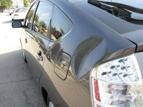 How to Remove a Car Dent with an Air Duster