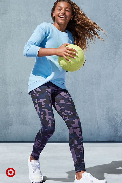 There's nothing better for fall layering than activewear kids can wear outside or in. This fleece top features a twist detail at the hem and pairs perfectly with fun patterned leggings.
