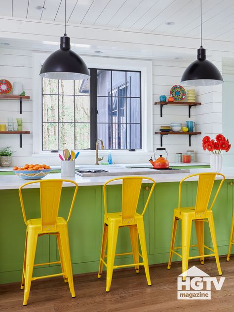 A bright green kitchen island, yellow stools and white shiplap make this modern farmhouse-y kitchen pop. See more on HGTV.com.