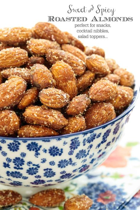 A delicious snack, cocktail nibble or salad topper, all in one easy recipe! But beware: these Sweet and Spicy Roasted Almonds are difficult to stop eating! #easyroastedalmonds, #sweetandspicyalmonds,#cocktailalmonds, #saladalmonds,