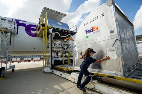 Sorting parcels to be loaded on to delivery vehicles at the FedEx - fedex jobs