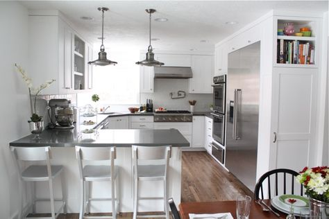 white u-shaped kitchen with peninsula, layout like ours