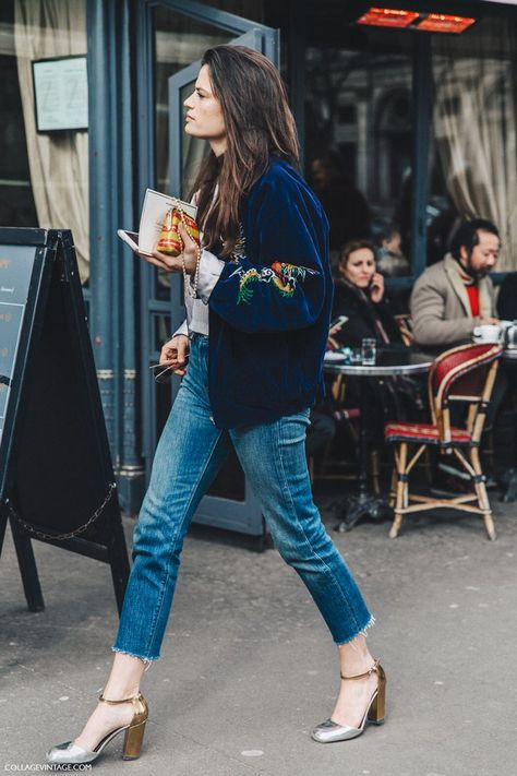 A bomber jacket and blue jeans.