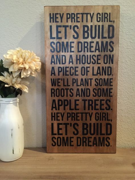 Hey pretty girl lets build some dreams and a house on a piece of land. Well plant some roots and some apple trees. Hey pretty girl, lets build some dreams.  This wood sign is 7 x 15 and is pictured in a RUSTIC BROWN with BLACK painted letters. All signs will be distressed (excluding the rustic option) unless otherwise requested!  (For a larger size - https://www.etsy.com/listing/181298021/kip-moore-song-hey-pretty-girl-large?)  IF YOU WOULD LIKE TO ADD NAMES AND/OR A DATE TO THIS SIGN…