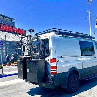 Sprinterventure Sprinter Van With Aluminess Gear Checking In At Ballast Point After A Long Hot Bike Ride Aluminess Roofrack Van Custom Vans Roof Rack