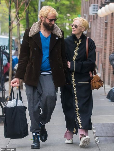 Tilda Swinton cuts a chic figure in a black kimono as she steps out in NYC with Sandro Kopp