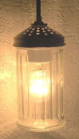 Pendant light from pizza shaker! I could see three or four of these over a kitchen island. (Etsy)