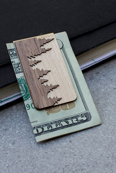 Give your groomsmen a gift they'll actually use. Skip the bulky wallet with this versatile money clip that can hold business cards, credit cards, and bills you need to travel light. Walnut and maple wood have beautiful wood grain that's perfect for engraving the message of your choice.