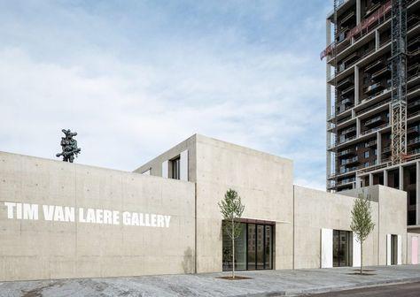 Five concrete boxes with pink doors form Antwerp's Tim Van Laere Gallery