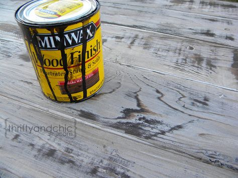 This is my favorite weathered wood stain technique - white paint, sand a little, stain with dark walnut, then seal. Thrifty and Chic - DIY Projects and Home Decor