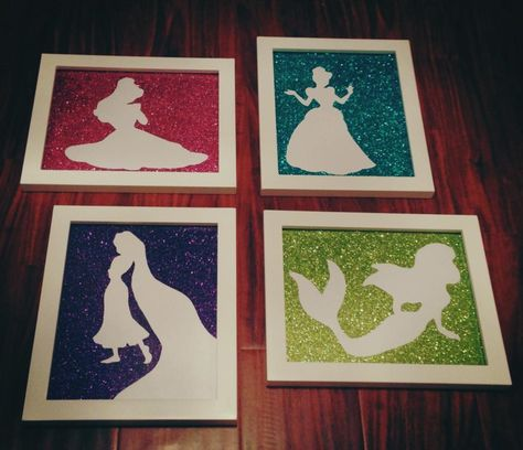Princess silhouettes for my girls bedroom! Michaels glitter paper, pearl white paper exacto cut into silhouette and framed!!!