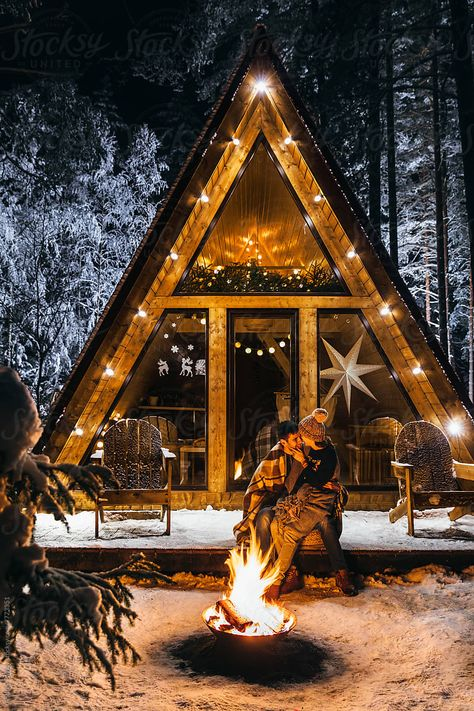 Loving couple spending Christmas holidays in an a-frame cabin outside the city in the woods. Girlfriend sitting on boyfriend's lap and smiling Winter Cabin, Cozy Cabin, Winter House, A Frame Cabin, A Frame House, Tiny House Cabin, Cozy House, Cabins In The Woods, House In The Woods