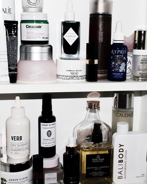 A skincare shelfie featuring: Herbivore Lapis Oil, Amore Pacific Essence, Dr Jart Cicapair, Complex Beauty Baby Face face mask, Bali Body body lotion, Sangre De Fruta Neroli Forever face mist, Glow Recipe Watermelon Overnight Sleeping Mask, Caudalie Essence, Farmacy Green Clean, Little Barn Apothecary, and more.