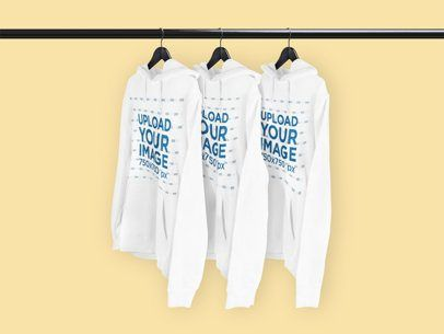 Download Placeit Mockup Of Three Pullover Hoodies Hanging From A Rack In 2021 Hoodie Mockup Clothing Mockup Cool Hoodies