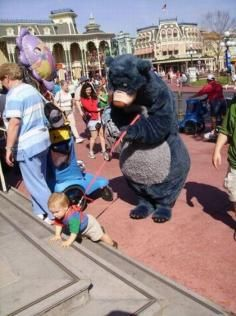 Leash On A Kid: A Bear Necessity In This Picture: Photo of bear with child on leash