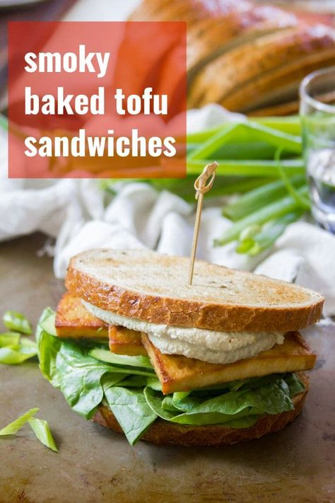 Baked tofu sandwiches with Asian flavors! These scrumptious sammies are stuffed with smoky baked tofu, crisp veggies, and slathered in kicky wasabi mayo. Packed with flavor and great for meal prep! #vegan #veganfood #veganrecipes #vegetarian #vegetarianrecipes #tofu #plantbased #meatlessmonday #sandwich #wasabi