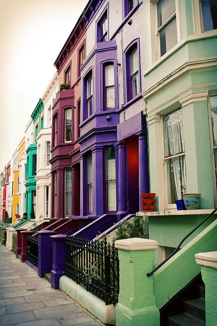 Lancaster Road, Notting Hill, London. Love the movie, so I'm sure I'd get a kick out of walking past these colorful homes.