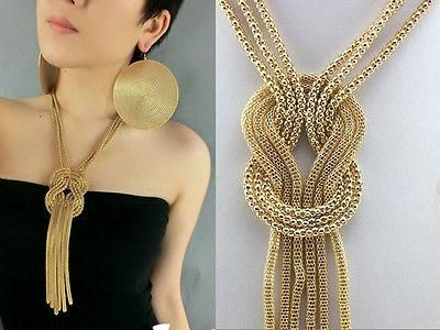 Gold tone necklace that could almost be your female version of a tie. This necklace could be worn with a variety of different outfits.