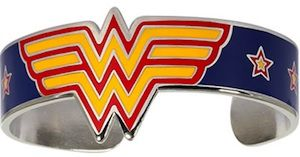 This is a neat and special bracelet based on Wonder Woman.    A metal bracelet with the Wonder Woman logo against a blue background.