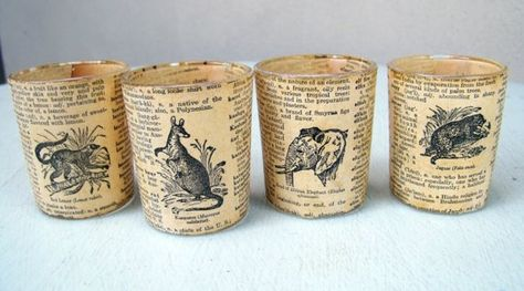 Small candle holders decoupaged with vintage book pages
