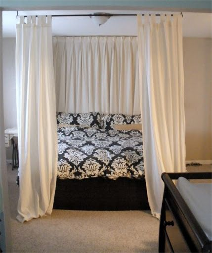 diy canopy bed - using curtain rods above bed onto ceiling! like how the  ones at the headboard are pulled across and the ones at the foot are ju