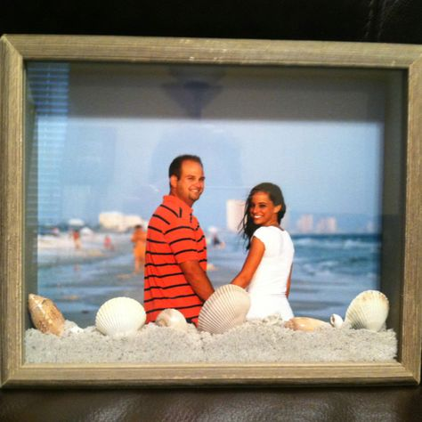 Shadow box frame of an engagement picture with sand and shells from the beach they were taken!