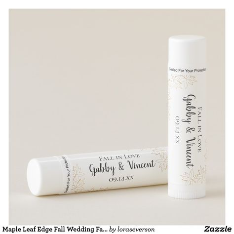 Maple Leaf Edge Fall Wedding Favor Lip Balm Personalize and date the natural Maple Leaf Edge Fall Wedding Lip Balm to create one of a kind party favors for your September, October or November bridal shower or marriage reception. Each custom woodsy lip balm features brown tone maple leaves with a white background and the words Fall in Love. #fallweddingtheme #fallweddingfavors #fallinlove #personalizedlipbalm #lipbalms