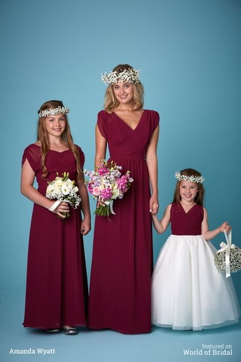 bridesmaids gowns with sleeves which can be worn on or off the shoulder shown here in burgundy chiffon and lavender chiffon.