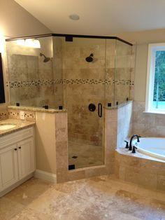 Frameless Corner Glass Shower. Dual Shower Heads. Garden Tub. Tiled Shower