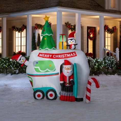 Animated Santa RV Camper Scene 2018 Christmas Inflatable.   Santa and Penguin friends are trying their hand at glamping. Santa is going high class camping now.. Santa is animated as he pops in and out of the camper door. Great Christmas decoration for you campers and lovers of the outdoors This inflatable will be a lot of fun