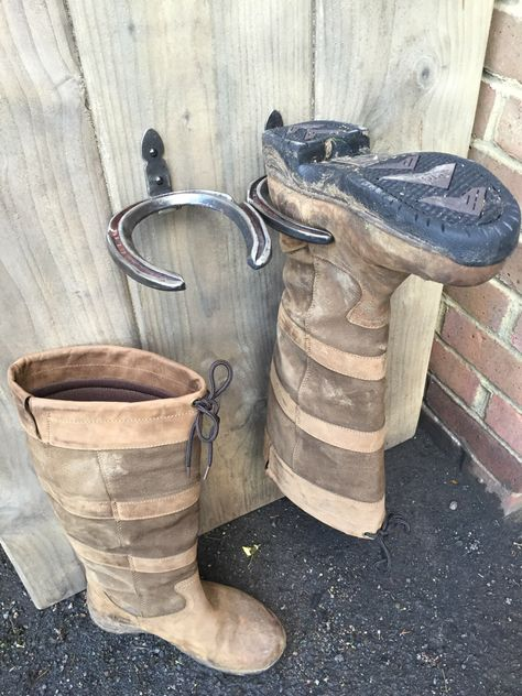 Home Decor Hallway Items similar to Hand Forged Horseshoe Riding Boot / Wellington Boot holders on Etsy.Home Decor Hallway Items similar to Hand Forged Horseshoe Riding Boot / Wellington Boot holders on Etsy Horseshoe Projects, Horseshoe Crafts, Horseshoe Art, Horseshoe Boot Rack, Welding Projects, Home Projects, Welding Crafts, Blacksmith Projects, Welding Art