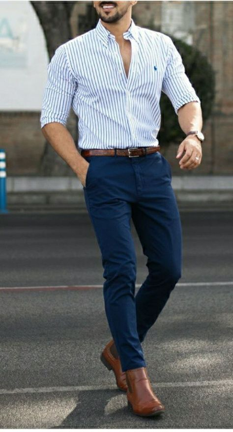 White shirt with vertical black stripes with brown leather belt and loafer, with blue trouser #menstyle #guystyle #fashiongrid #styleguide #classicoutfits #menswear #brownloafer #gq #brownbelt #brownleatherbelts #formalwear #bluetrousers #summeroutfit #mensapparel #mensstyle