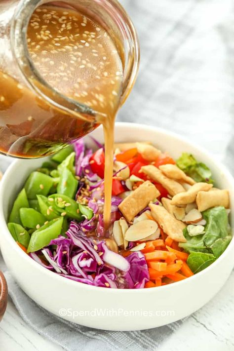 Homemade sesame ginger dressing is an Asian inspired dressing with the perfect balance of sweet & spicy. Made with ingredients like rice wine vinegar, sriracha, and honey, it is the perfect dressing for a salad, marinade for meat, or dipping sauce for bread or crispy noodles. #spendwithpennies #sesamegingerdressing #saladdressing #asianinspired #asiandressing #homemadedressing