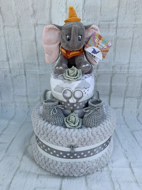 Absolutely stunning dumbo character adorns this nappy cake with its soft waffle . Absolutely stunning dumbo character adorns this nappy cake with its soft waffle blanket, printed muslin square and so much more shower ideas for a boy Baby Shower Nappy Cake, Baby Nappy Cakes, Cadeau Baby Shower, Idee Baby Shower, Elephant Diaper Cakes, Diy Diaper Cake, Fiesta Baby Shower, Baby Shower Diapers, Unique Diaper Cakes