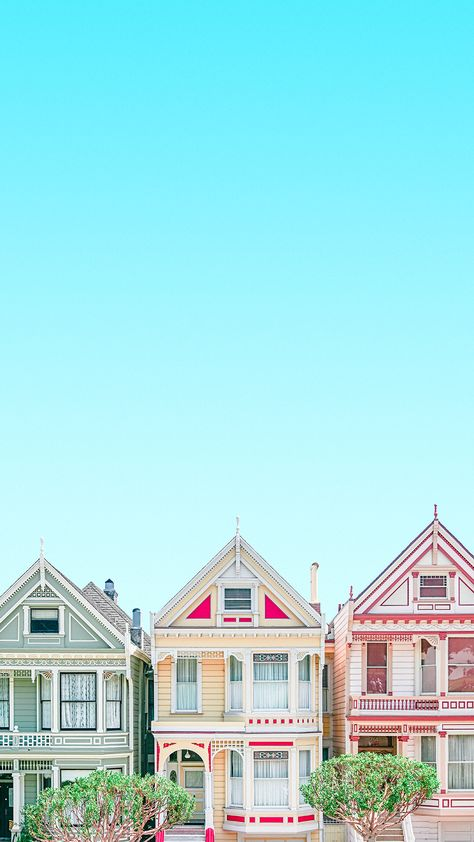 Gorgeous colourful San Francisco homes under a bright blue clear sky