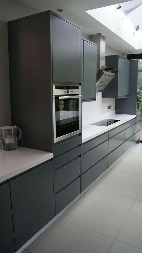 Modern handle-less grey matt painted bespoke kitchen with white - alno küchen trier