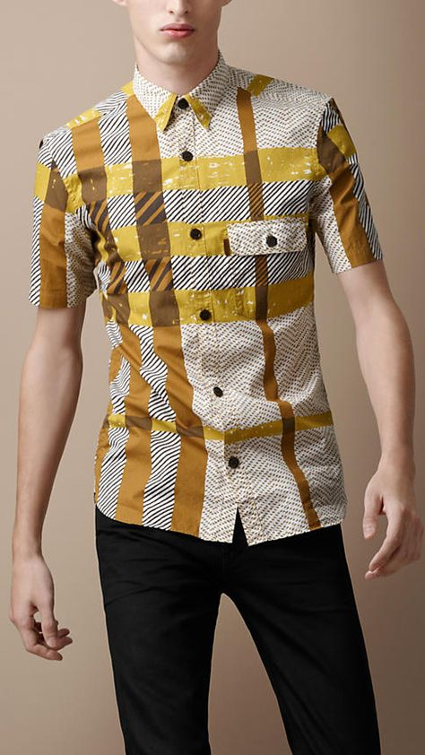 Burberry eclectic short sleeve printed shirt in gold, yellow and white.