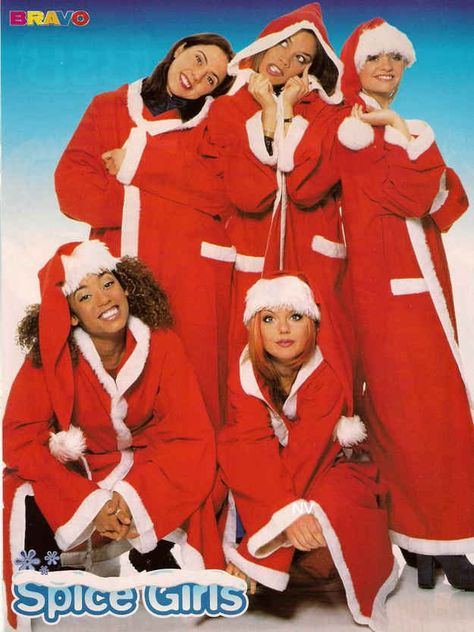 Geri is clearly not OK being completely covered up. She's just waiting to bust out of her santa robes in fishnets and a corset. | 18 Extremely Awkward Celebrity Christmas Photoshoots