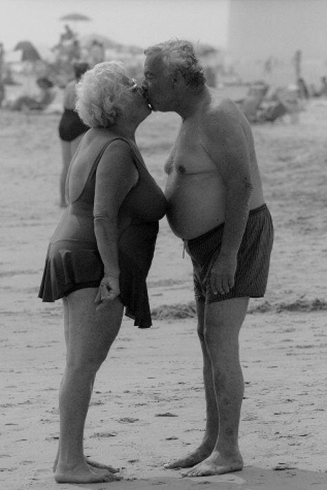 Heavysetters along Brighton Beach and Boardwalk. An elderly couple kisses.