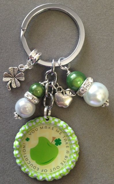 This listing is for one Teacher saying bottle cap key chain.  This key chain was custom made for the end of the year teacher gifts! The key chain is embellished with pearl like and green beads, a clover charm and an apple charm.  Graphics done by printablegirl.com  Have a great day!  Laura