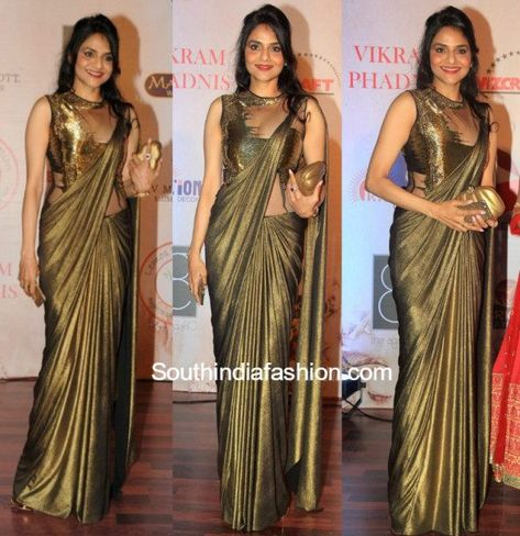 Madhoo Shah in Gaurav Gupta Saree Gown – Madhoo Shah was spotted at the 25th anniversary celebrations of designer Vikram Phadnis in a metallic golden Gaurav Gupta saree gown. Half-up hairstyle and a gold clutch completed her look. She looked