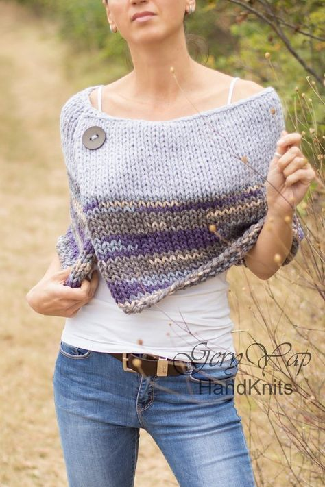 This warm poncho is hand knitted by me of thick woolen blend yarn in light gray blue color and multicolor yarn. The poncho has a decorative button close to the neckline. It is so soft and cosy that you`ll really love it! This hand made garment is perfect for the autumn chily mornings and