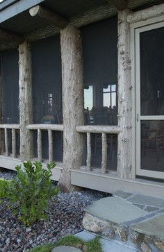 beautiful screened porch using trees as part of structure.....  Adirondack Style Boathouse