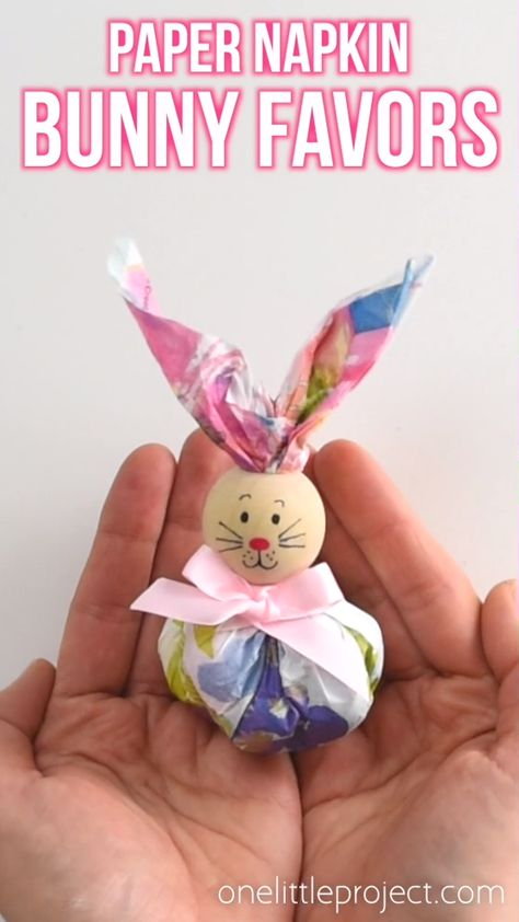 These paper napkin bunny favors are SO CUTE! And they're really easy to make! With dollar store paper napkins and foil covered chocolate eggs you can make adorable Easter treats to give away to the kids, grandkids or even to the classroom at school! They'd even make super cute decorations for the Easter table. This is such a fun and simple Easter craft idea.