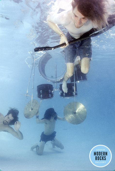 Nirvana pool photos taken by Kirk Weddle in November of feature Dave Grohl, Krist Novoselic and Kurt Cobain frolicking in a pool and underwater action shots with their instruments.